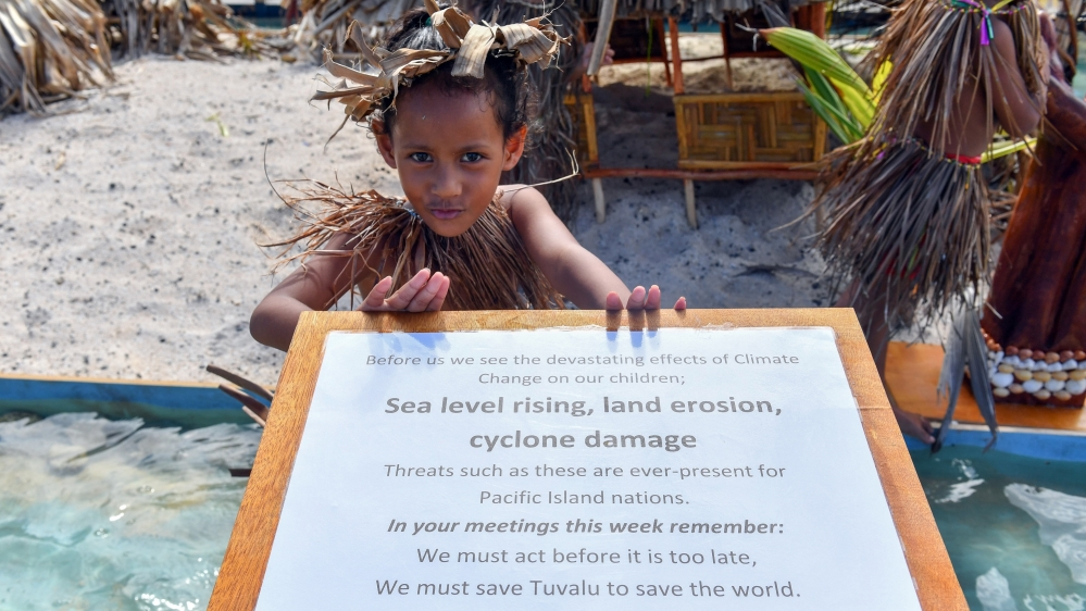 A child waits for New Zealand's Prime Minister Jacinda Ardern to arrive for the Pacific Islands Forum (PIF) in Funafuti, Tuvalu, 14 August 2019