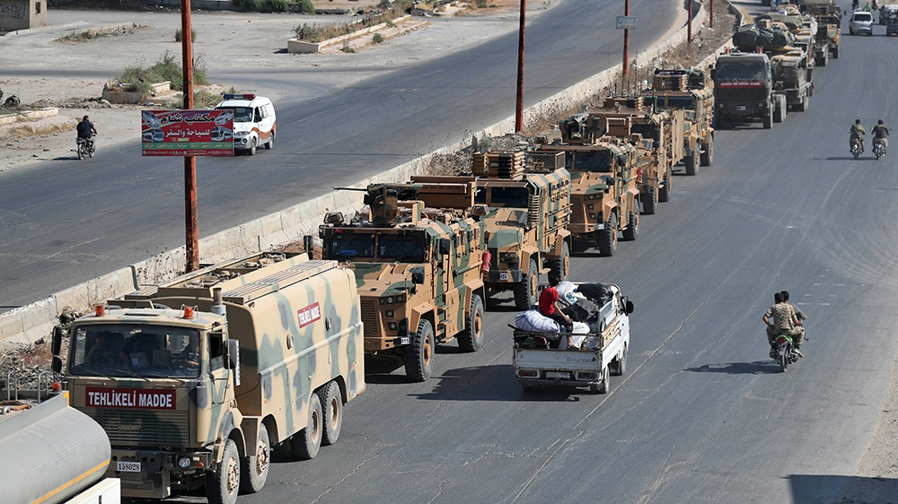 A convoy of Turkish military vehicles passes through Maaret al-Numan in Syria