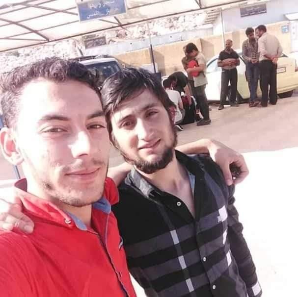 Hisham Bab Al Hawa: The photo sent to Abu Hisham after his Mustafa (R) crossed the border back into Syria and was met by his friend. Provided by Abu Hisham.