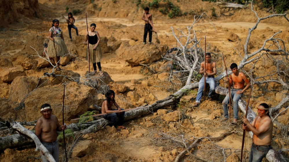 Indigenous people from the Mura tribe show a deforested area in unmarked indigenous lands inside the Amazon rainforest near Humaita, Amazonas State, Brazil August 20, 2019.