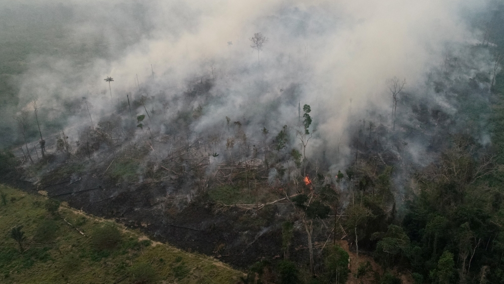 An aerial view of a tract of the Amazon jungle burning as it is being cleared by loggers and farmers in Porto Velho, Rondonia State, Brazil