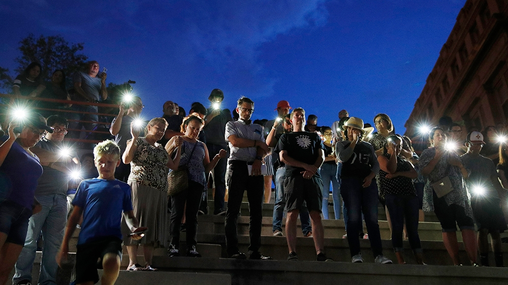 People attend a vigil for victims of the shooting Saturday, Aug. 3, 2019, in El Paso, Texas. (AP Photo/John Locher)