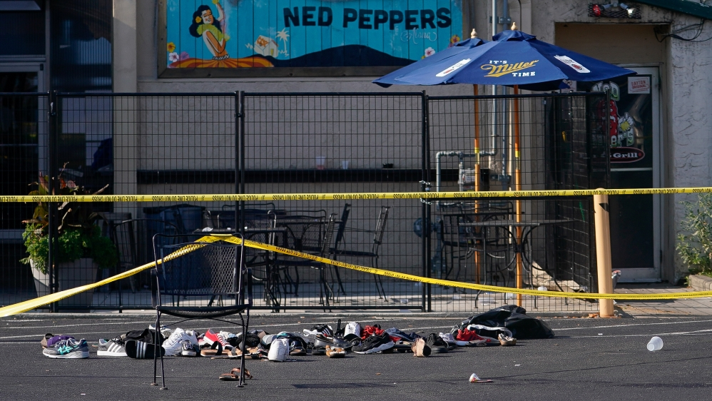 Shoes are piled in the rear of Ned Peppers Bar at the scene after a mass shooting in Dayton