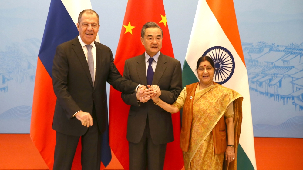 Russian Foreign Minister Sergei Lavrov, Chinese State Councillor and Foreign Minister Wang Yi and Indian External Affairs Minister Sushma Swaraj pose for a photo before their meeting in Wuzhen