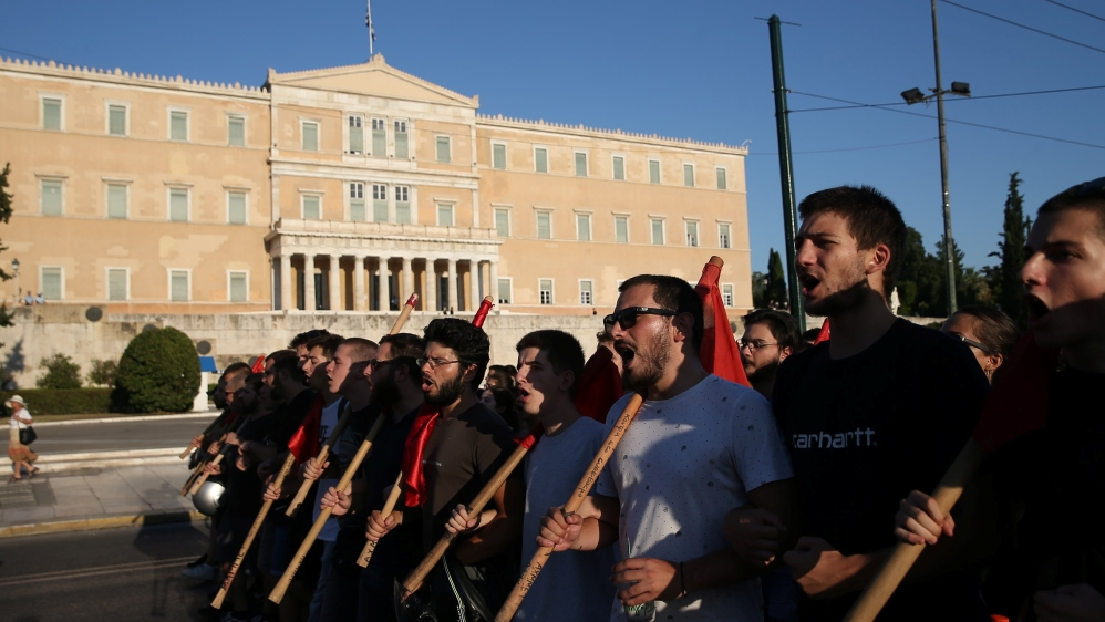 Students shout slogans as they take part in a rally against the abolishment of academic asylum in Athens