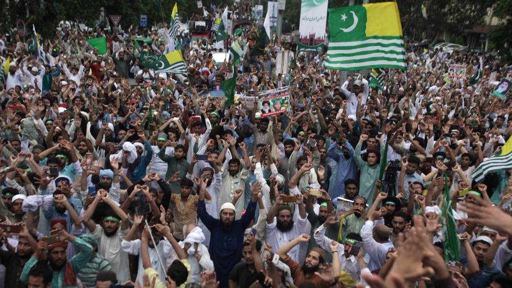 People rally to express solidarity with the people of Kashmir, in Lahore