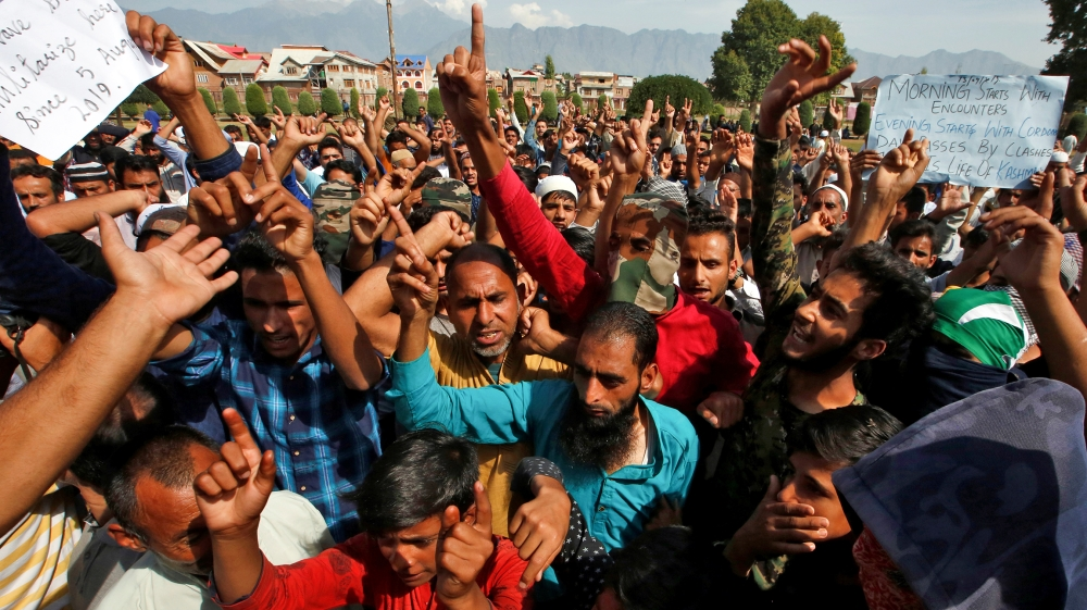Kashmiris shout slogans at a protest site after Friday prayers during restrictions, following scrapping of the special constitutional status for Kashmir by the Indian government, in Srinagar September