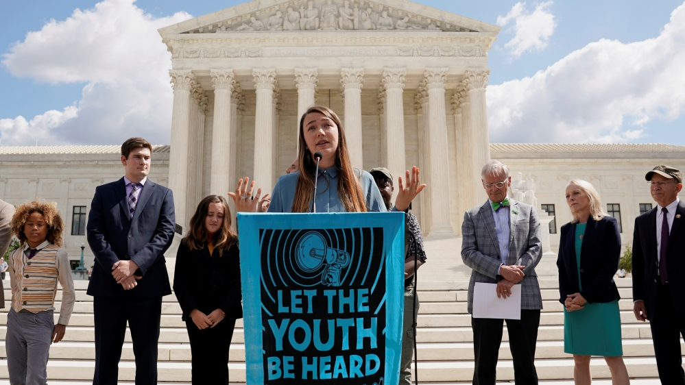Plaintiff Kelsey Juliana speaks at the Supreme Court in Washington