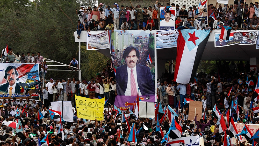 Yemeni supporters of the Southern Separatist Movement hold former South Yemen flags during a rally in Aden, Yemen, Sunday, Jan. 13, 2013. The rally commemorates the anniversary of a civil war that bro