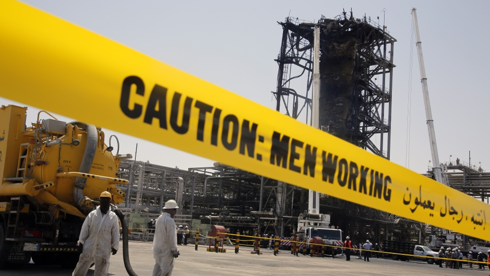 In this photo opportunity during a trip organized by Saudi information ministry, workers work in front of the recent attack Aramco's oil processing facility in Khurais, near Dammam