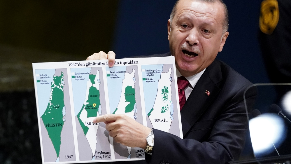 Turkey's President Recep Tayyip Erdogan holds up a map as he addresses the 74th session of the United Nations General Assembly at U.N. headquarters in New York City