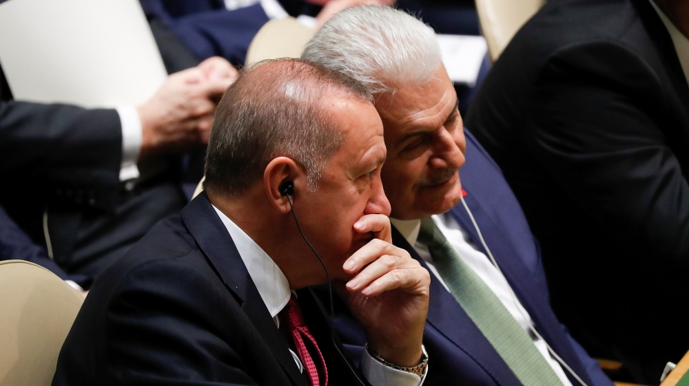 Turkey's President Recep Tayyip Erdogan alks with a member of his delegation during the 74th session of the United Nations General Assembly