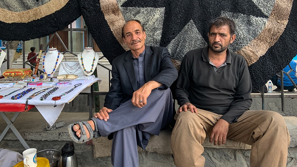 Mohammad Mustafa (R), a retired Air Force general, says no matter who the winner is, he wants an end to the political infighting and name calling that has plagued previous administrations in Afghanist
