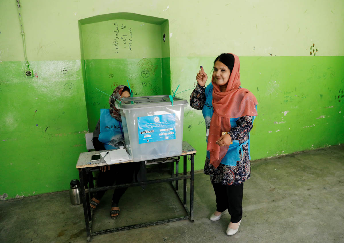 Some 9.6 million people registered to vote in the presidential election. [Mohammad Ismail/Reuters]