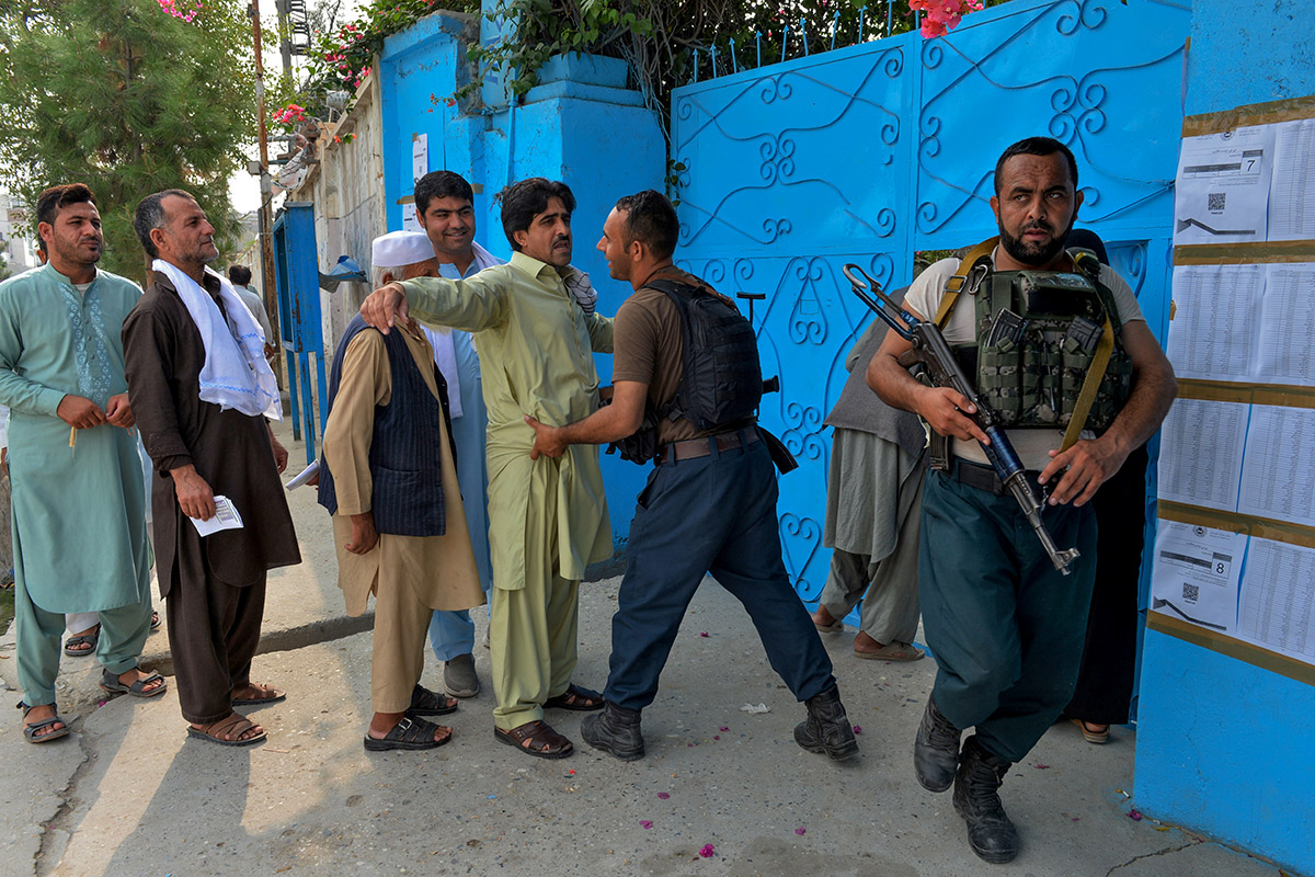 To protect voters and polling stations, tens of thousands of Afghan forces were deployed across the country. [Noorullah Shirzada/AFP]