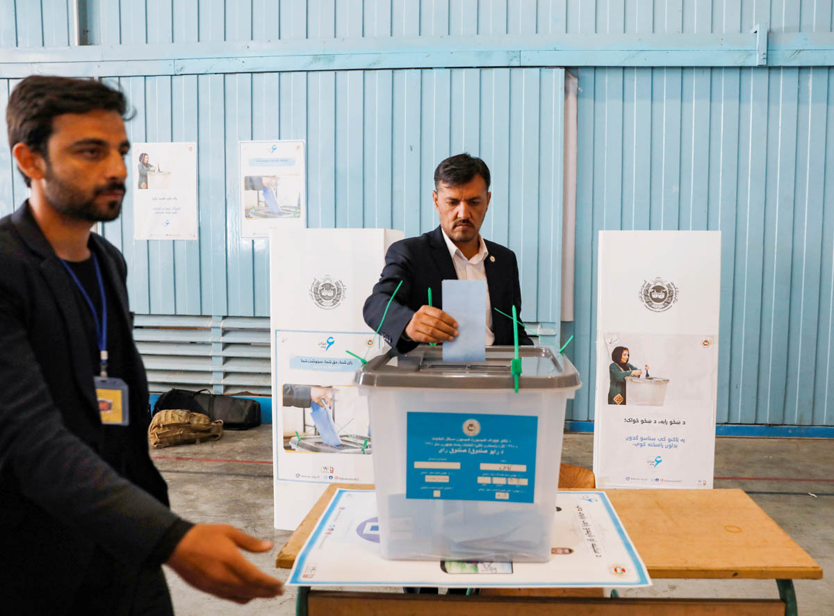 A presidential candidate must secure 50 percent of the vote to win outright. If no candidate crosses the threshold, a runoff will be held between the top two contenders - most likely on November 23. [Mohammad Ismail/Reuters]