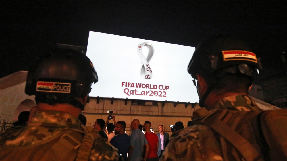 Iraqis gather at Baghdad's Tahir square as the official logo of the FIFA World Cup Qatar 2022 is projected on the front of a building on September 3, 2019. Qatar unveiled the logo for the 2022 World C