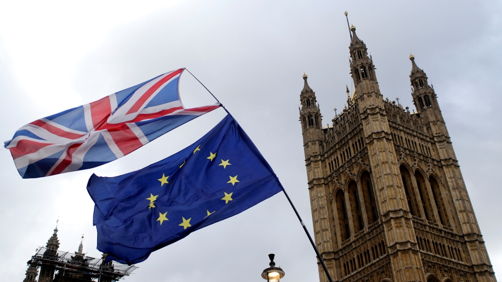 Flags flutter outside the Houses of Parliament, ahead of a Brexit vote, in London, Britain March 13, 2019