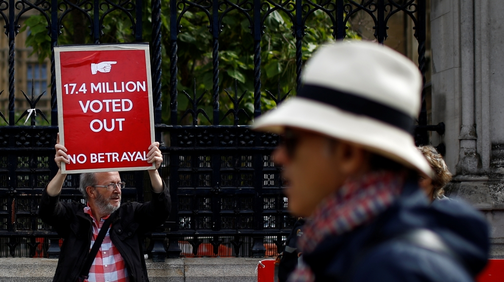 Pro-Brexit protester holds a placard as they demonstrate at Westminster in London, Britain, September 4, 2019
