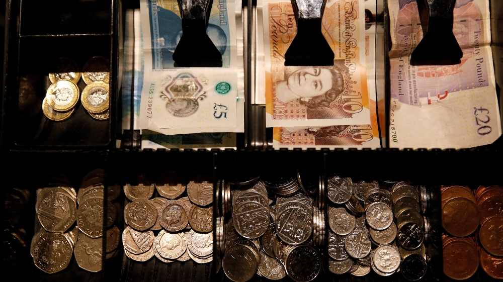 Pound Sterling notes and change are seen inside a cash resgister in a coffee shop in Manchester, Britain, September 21, 2018