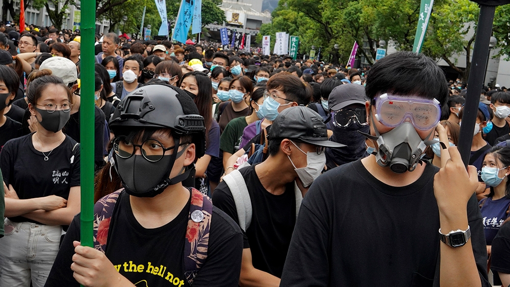 University student wearing safety gear join a strike on the first day of school at the Chinese University in Hong Kong, on Monday, Sept. 2, 2019. The nearly three months of youth-dominated protests ca