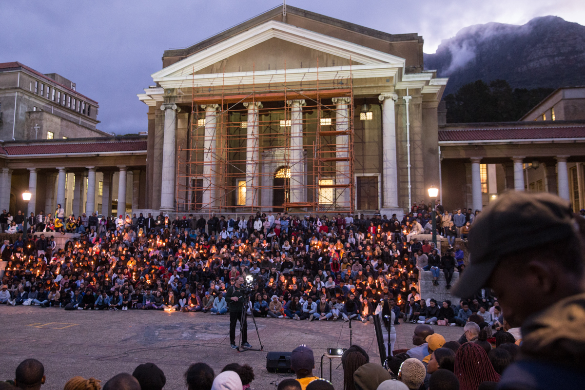 Hundreds of students gather at UCT for a night vigil for Uyinene Mrwetyana. Vigils were also held at Stellenbosch University and the University of the Witwatersrand in Johannesburg. [Ashraf Hendricks/Al Jazeera]