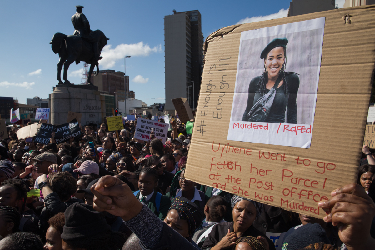 Thousands of protesters, mostly women, school pupils and university students gather outside parliament calling on the government to address the issue of violence against women in South Africa. According to the South African Police Service, 20, 336 people were murdered in South Africa in 2017-2018 including 3,224 women and girls. [Ashraf Hendricks/Al Jazeera]