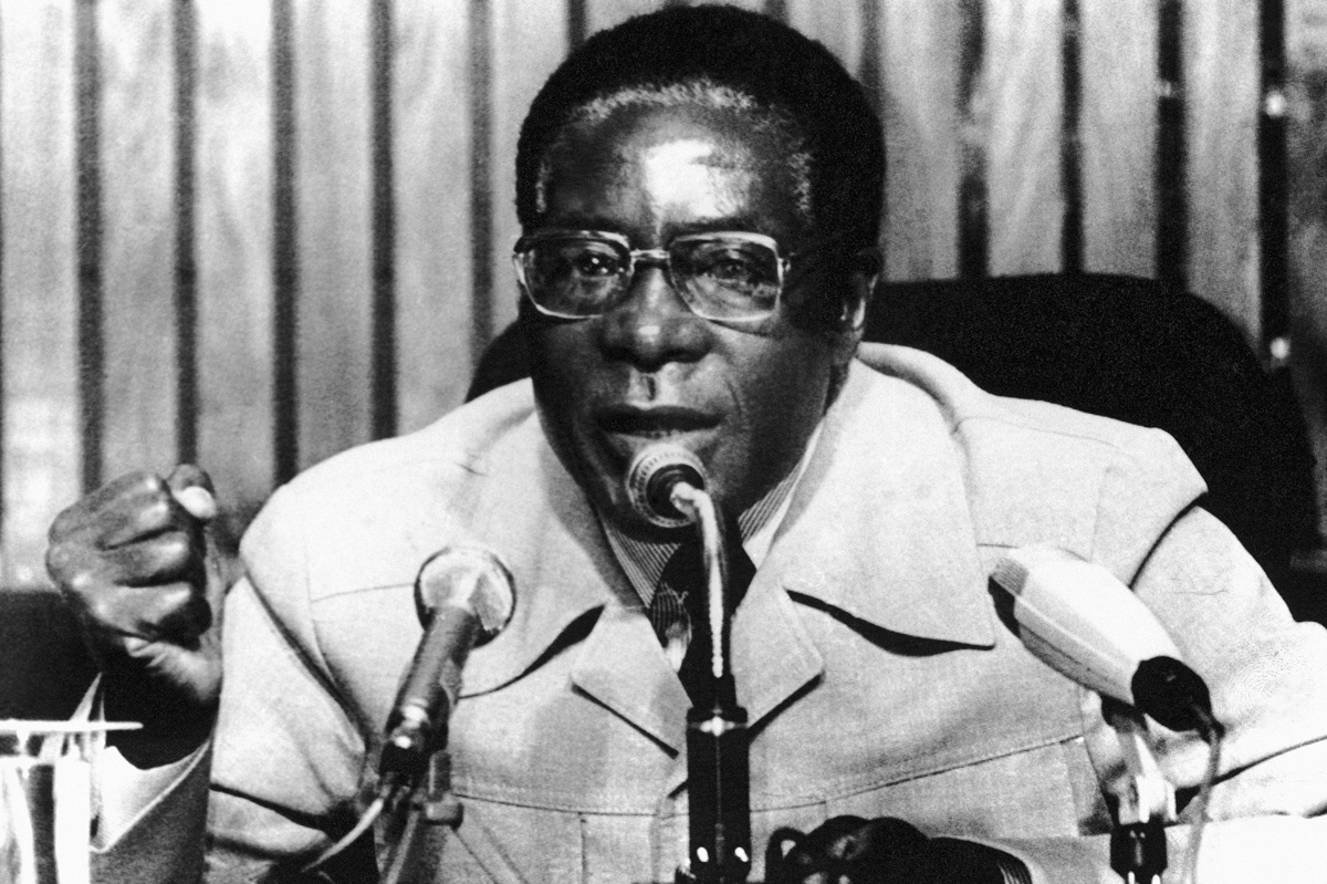 When Mugabe took power, Zimbabwe began to recover from conflict. But a land reform policy that saw black farmers take over white-owned farms sparked domestic outrage. [AP Photo]