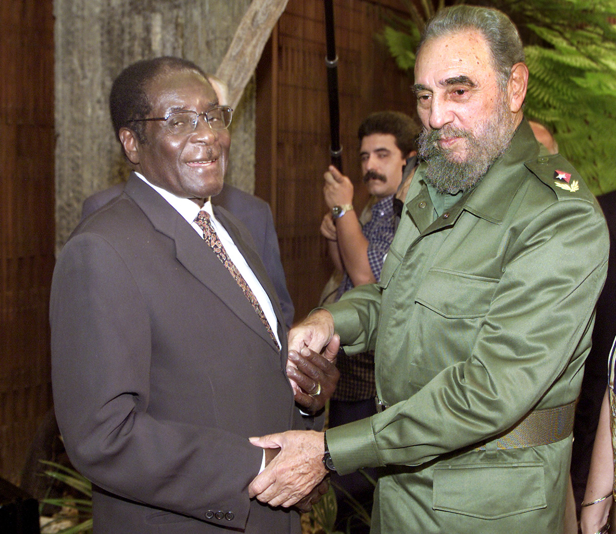 During his time in power, Mugabe met Cuba's President Fidel Castro several times. He praised his government for having trained thousands of Zimbabwean doctors and teachers. [Jose Goitia/AP Photo]