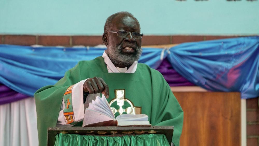 Priest [Tendai Marima/Al Jazeera]