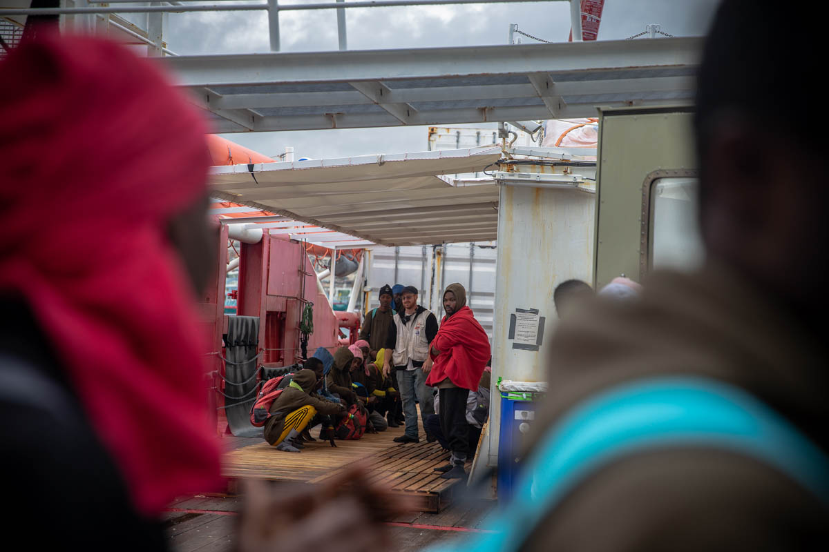 As the rescued people prepare to disembark in Europe, they realise stern tests await them in front of immigration officials and that their journey is not over. More than 5,000 migrants were forcibly repatriated by Italy in 2019. For those who are returned, the violence, torture and extortion they endured on their journey was for nothing. [Faras Ghani/Al Jazeera]