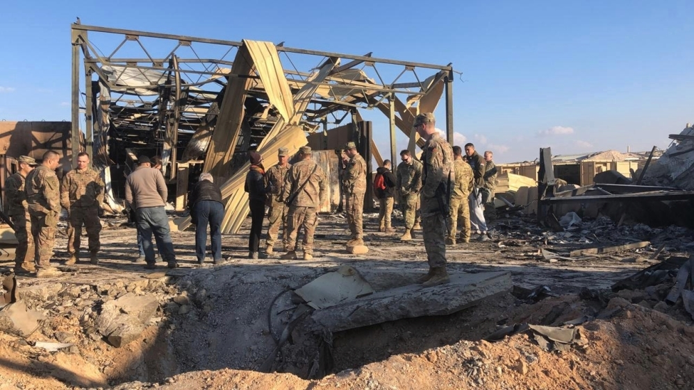 U.S. Soldiers stand at a site of Iranian bombing at Ain al-Asad air base in Anbar, Iraq, Monday, Jan. 13, 2020. Ain al-Asad air base was struck by a barrage of Iranian missiles on Wednesday, in retali