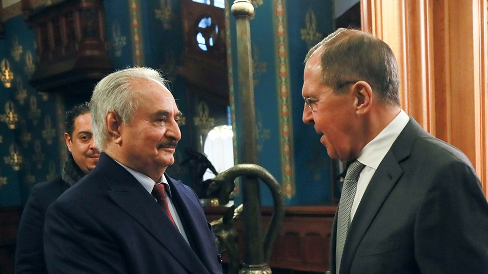 This handout picture released by the Russian Foreign Ministry on January 13, 2020 shows Russian Foreign Minister Sergei Lavrov welcoming Libya's military strongman Khalifa Haftar in Moscow. (Photo by