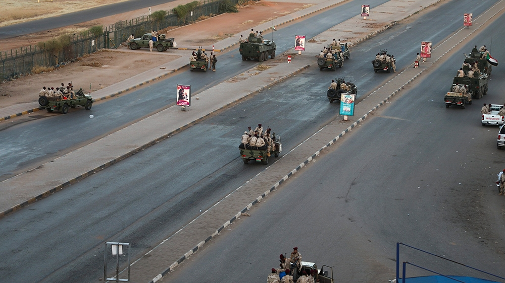 Members of the Rapid Support Forces, a paramilitary force operated by the Sudanese government, block roads in Khartoum, Sudan, Tuesday, Jan. 14, 2020. A Sudanese official said Tuesday that security fo