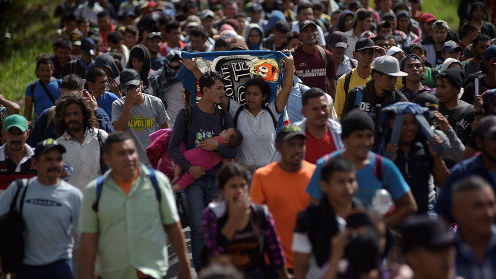 Hundreds of migrants ford river from Guatemala to Mexico