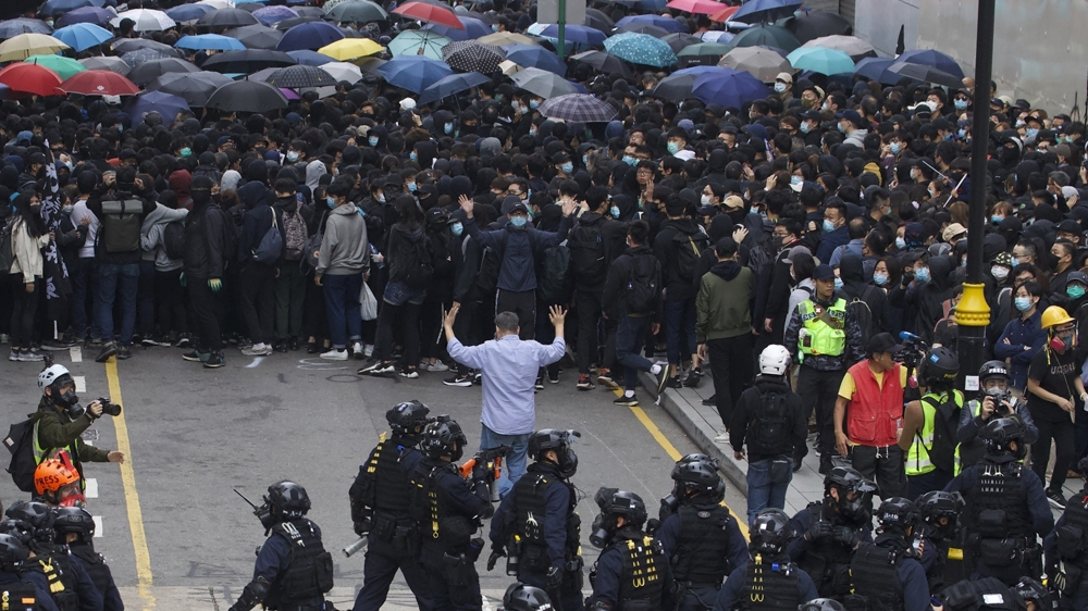 Swat police corner protesters calling for electoral reforms and a boycott of the Chinese Communist Party in Hong Kong,
