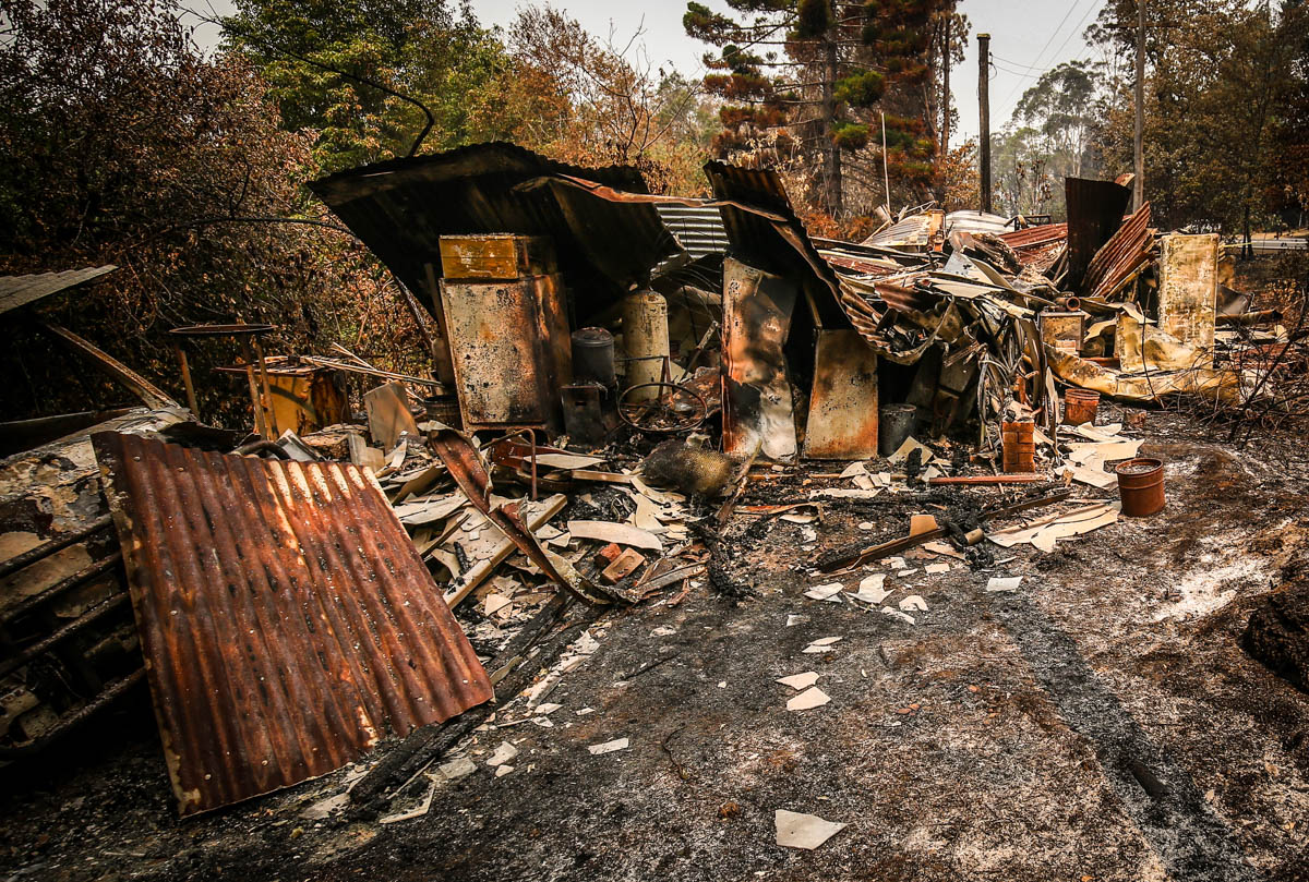 A home recently destroyed by bushfires can be seen near the town of Bilpin in Sydney. [David Gray/Getty Images]
