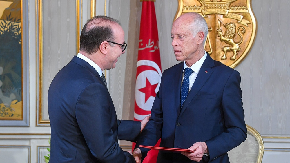 Tunisian President Kais Saied (R) gives letter of tasking to Tunisian former Finance Minister Elyes Fakhfakh (L) to form new government at the Carthage Palace in Tunis, Tunisia on January 21, 2020. (