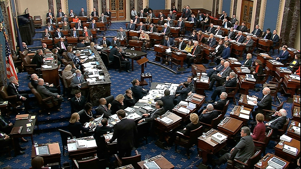 In this image from video, Senators vote on approving the rules for the impeachment trial against President Donald Trump in the Senate at the U.S. Capitol in Washington, Wednesday, Jan. 22, 2020. Senat
