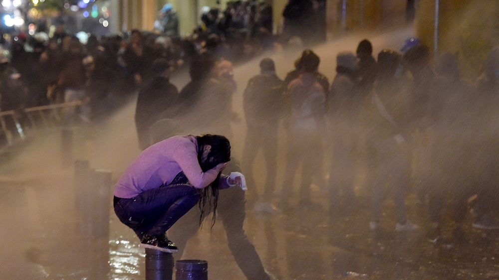 Lebanese riot police spray water at protesters during continuous anti-government protests outside of the Lebanese Parliament building in downtown Beirut, Lebanon, 22 January 2020. Lebanon announced on