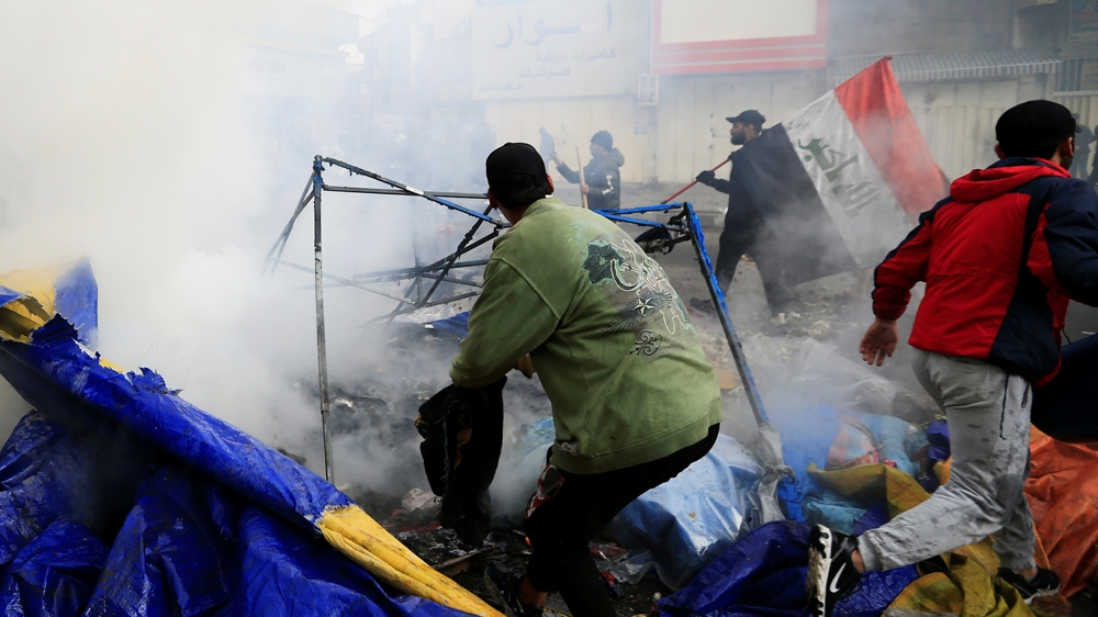 Smoke rises from burning tents as Iraqi security forces raid at Tahrir Sq. all the strategy in which through ongoing anti-government protests in Baghdad, Iraq January 25, 2020. REUTERS/Thaier al-Sudani