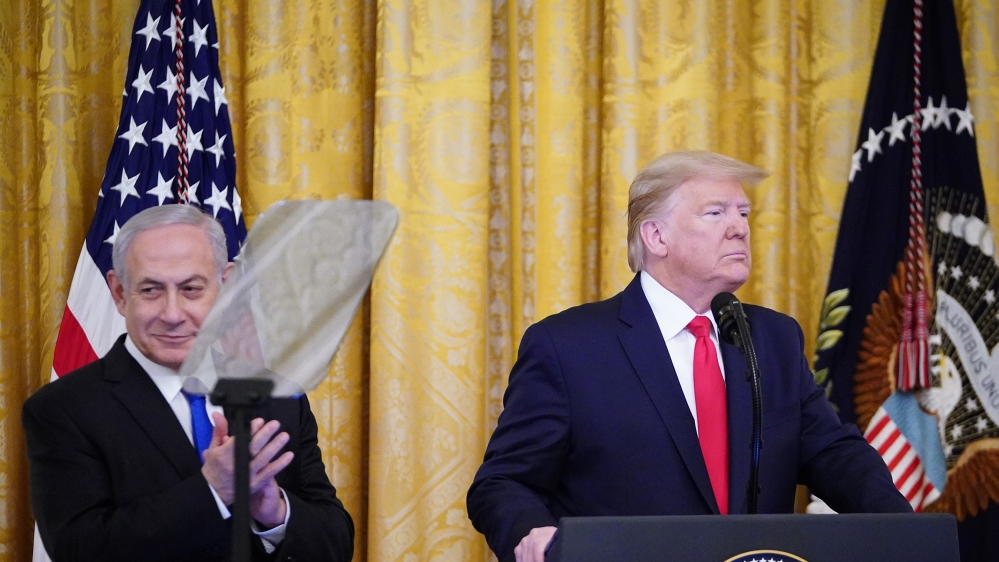 US President Donald Trump and Israel's Prime Minister Benjamin Netanyahu take part in an announcement of Trump's Middle East peace plan in the East Room of the White House in Washington, DC on January