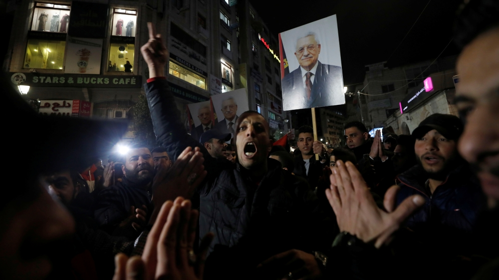 Demonstrators hold pictures of Palestinian President Mahmoud Abbas during a protest against the U.S. President Donald Trump's Mideast peace plan, in Ramallah in the Israeli-occupied West Bank
