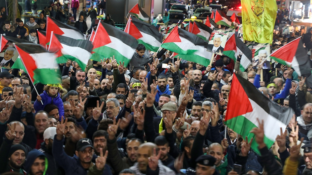 Palestinians take part in a demonstration in the West Bank city of Nablus on January 28, 2020, to protest against US President Donald Trump's peace plan proposal. - Palestinians staged protests agains