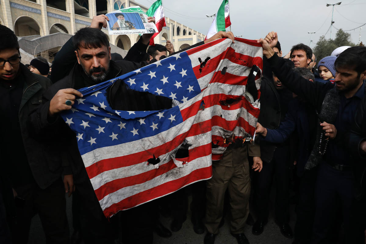 Protesters burn a U.S. flag during a demonstration over the U.S. airstrike in Iraq that killed Iranian Revolutionary Guard Gen. Qassem Soleimani, in Tehran, Iran, Jan. 3, 2020. Iran has vowed