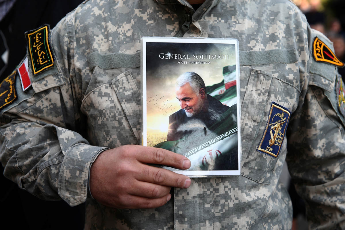 A demonstrator holds the picture of Qassem Soleimani during a protest against the assassination of the Iranian Major-General Qassem Soleimani, head of the elite Quds Force, and Iraqi militia commander