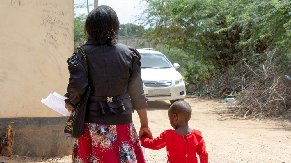 Angeline Munanie, a teacher at Warable Primary School in Garissa County, is terrified for herself and her child [Abdullahi Mire/Al Jazeera]