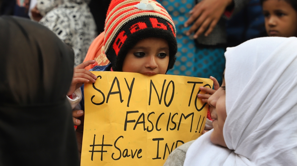 A kid holds a placard during a protest against the citizenship amendment act and NRC in New Delhi India on 01 January 2020 (Photo by Nasir Kachroo/NurPhoto via Getty Images)