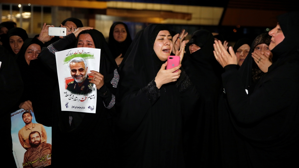 Iranian mourners react upon the arrival of bodies of the Iranian Major-General Qassem Soleimani, head of the elite Quds Force, and the Iraqi militia commander Abu Mahdi al-Muhandis, who were killed in