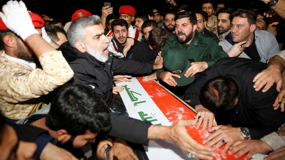Iranian mourners react over the coffin of the Iraqi militia commander Abu Mahdi al-Muhandis, at Ahvaz international airport, in Ahvaz